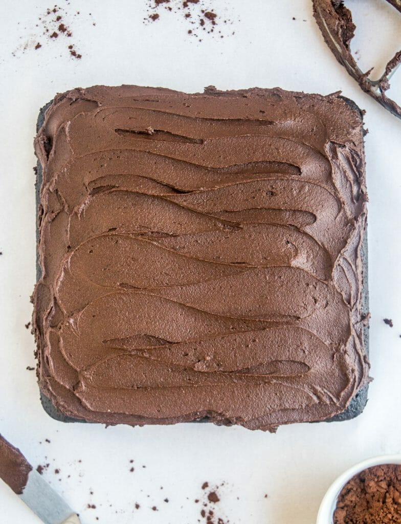 Overhead shot of a chocolate cake with fudgy chocolate buttercream