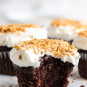 chocolate coconut cupcake with a bite out of it