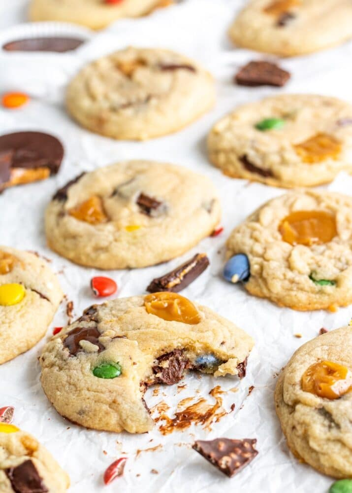 halloween candy cookies with pieces of candy scattered around