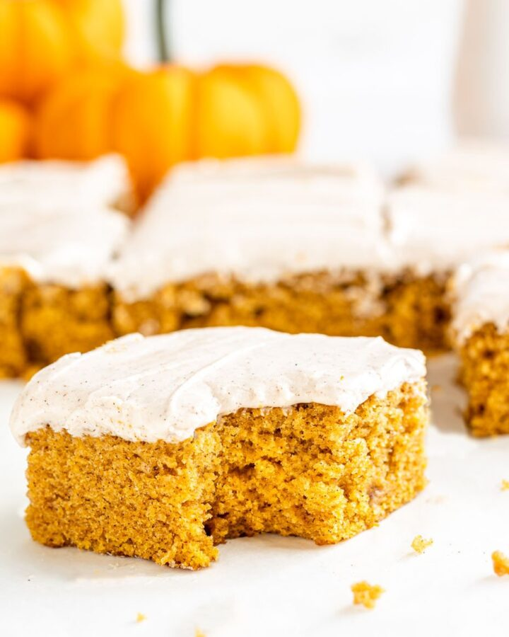 pumpkin sheet cake with a bite out of it
