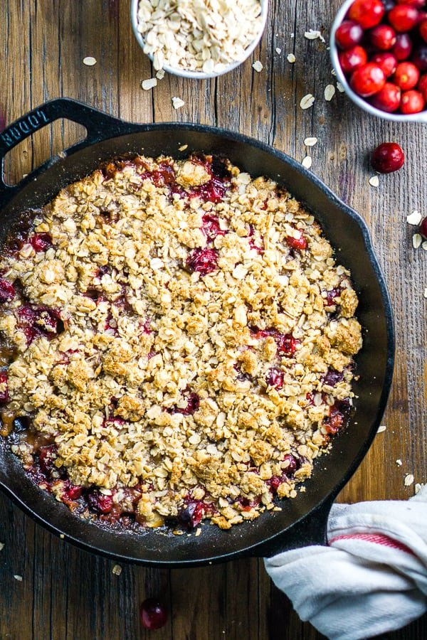 dairy free pear apple cranberry crisp in a skillet