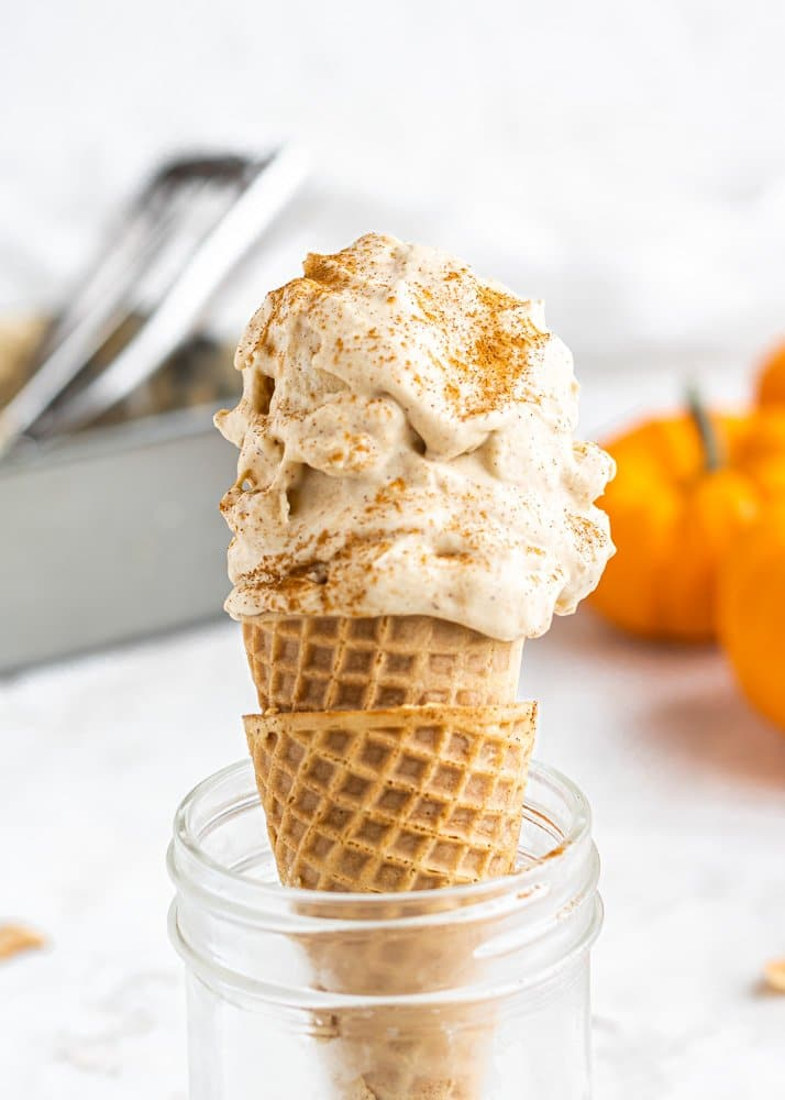 dairy free pumpkin ice cream in a cone close up