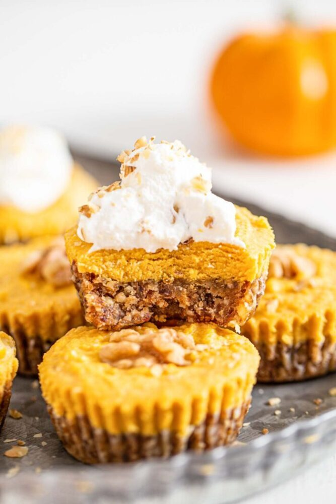 a dairy free pumpkin tart with a bite taken out of it