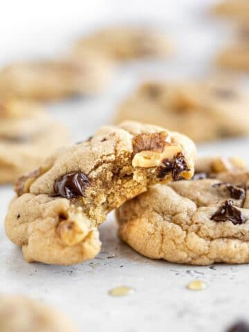 two maple chocolate chip cookies stacked
