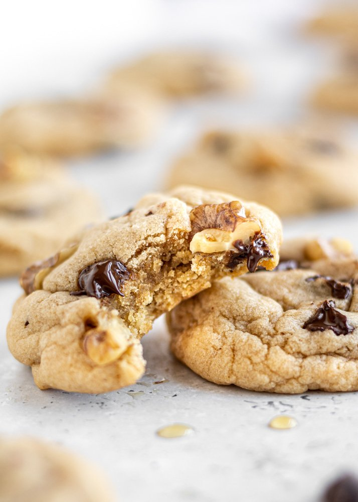 maple chocolate chip cookie with a bite out of it