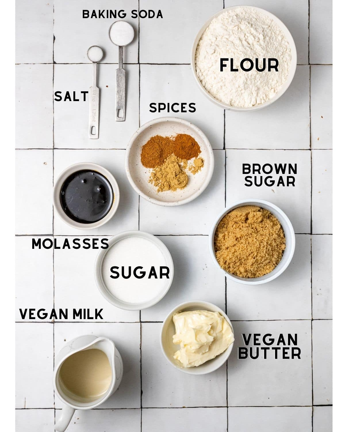 ingredients needed to make vegan ginger cookies in bowls with labels