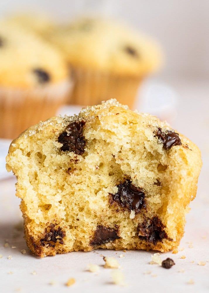 a chocolate chip muffins split in half close up