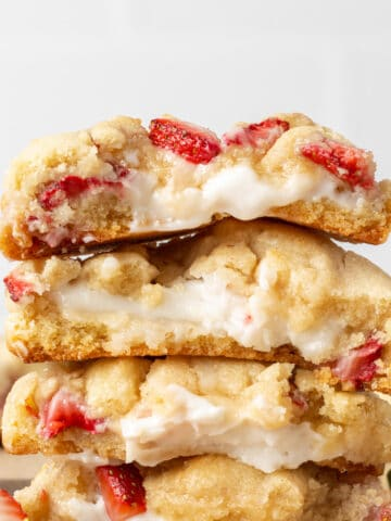 strawberry cheesecake cookies split in half showing the inside of the cookies
