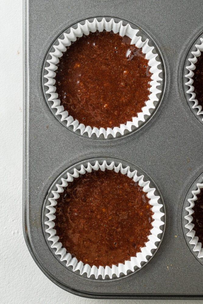 chocolate orange cupcake batter in liners before baking