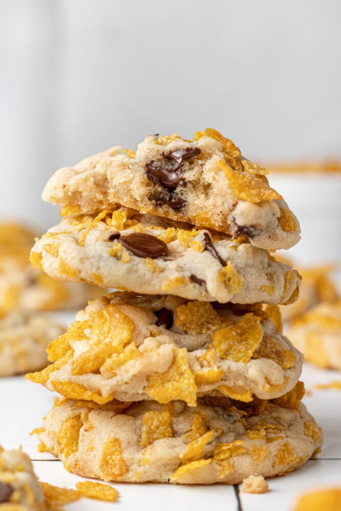 corn flakes cookies stacked on each other with a bite out of one cookie