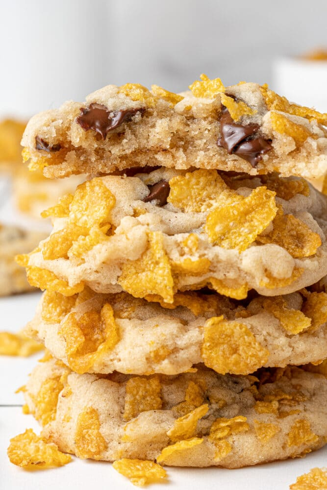 corn flakes cookies stacked on each other with chocolate chips inside