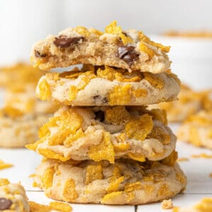 corn flakes cookies stacked on each other with more cookies scattered around