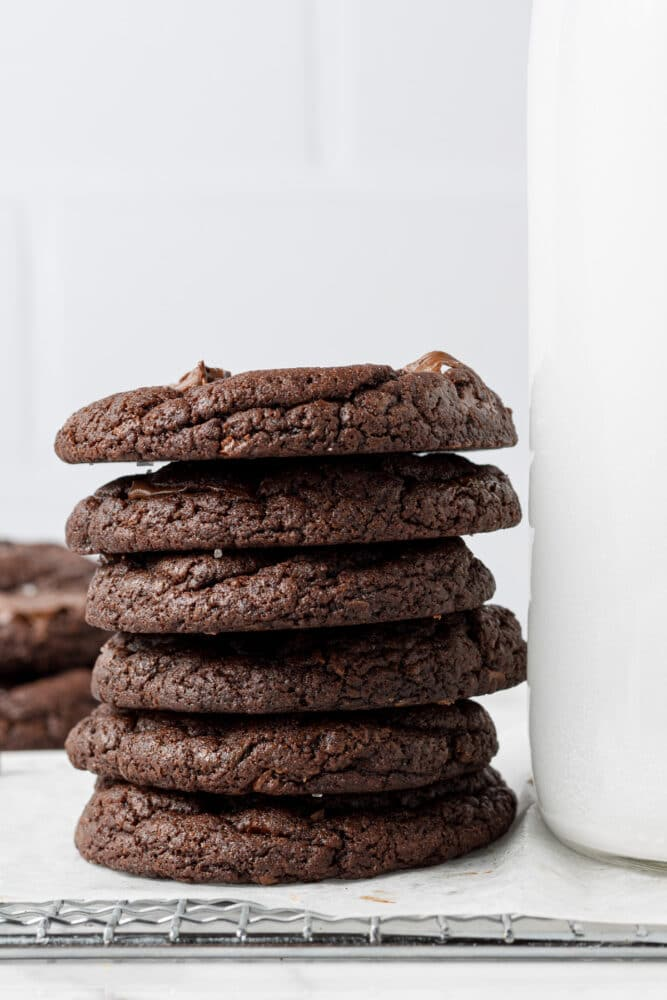 vegan double chocolate chip cookies stacked on each other