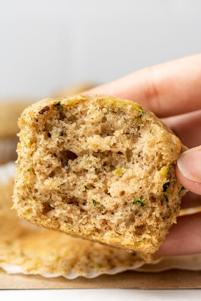 hand holding a vegan zucchini muffin