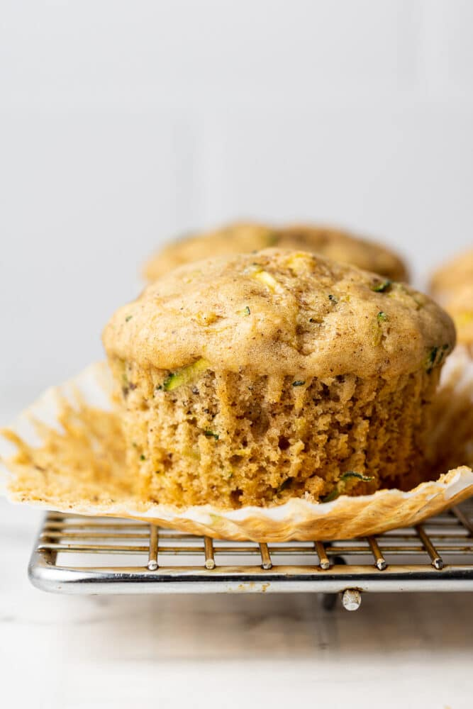 vegan zucchini muffin on a cooling rack