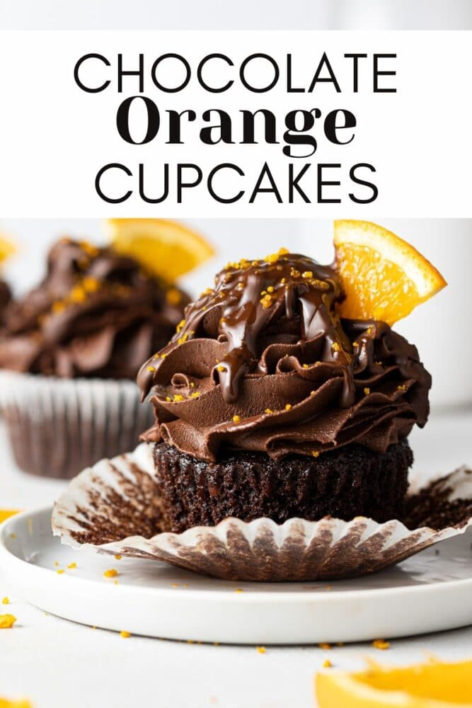 a chocolate orange cupcake on a plate with orange slices scattered around it and text overlay for pinterest