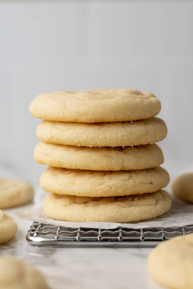 dairy free sugar cookies stacked on each other