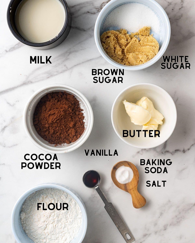 ingredients to make vegan mug cake in bowls with text overlay