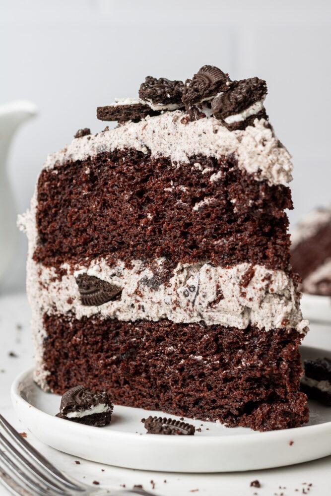 a slice of vegan oreo cake on a plate