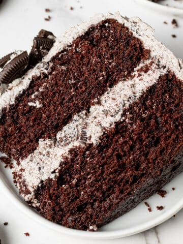 a slice of vegan oreo cake on a plate