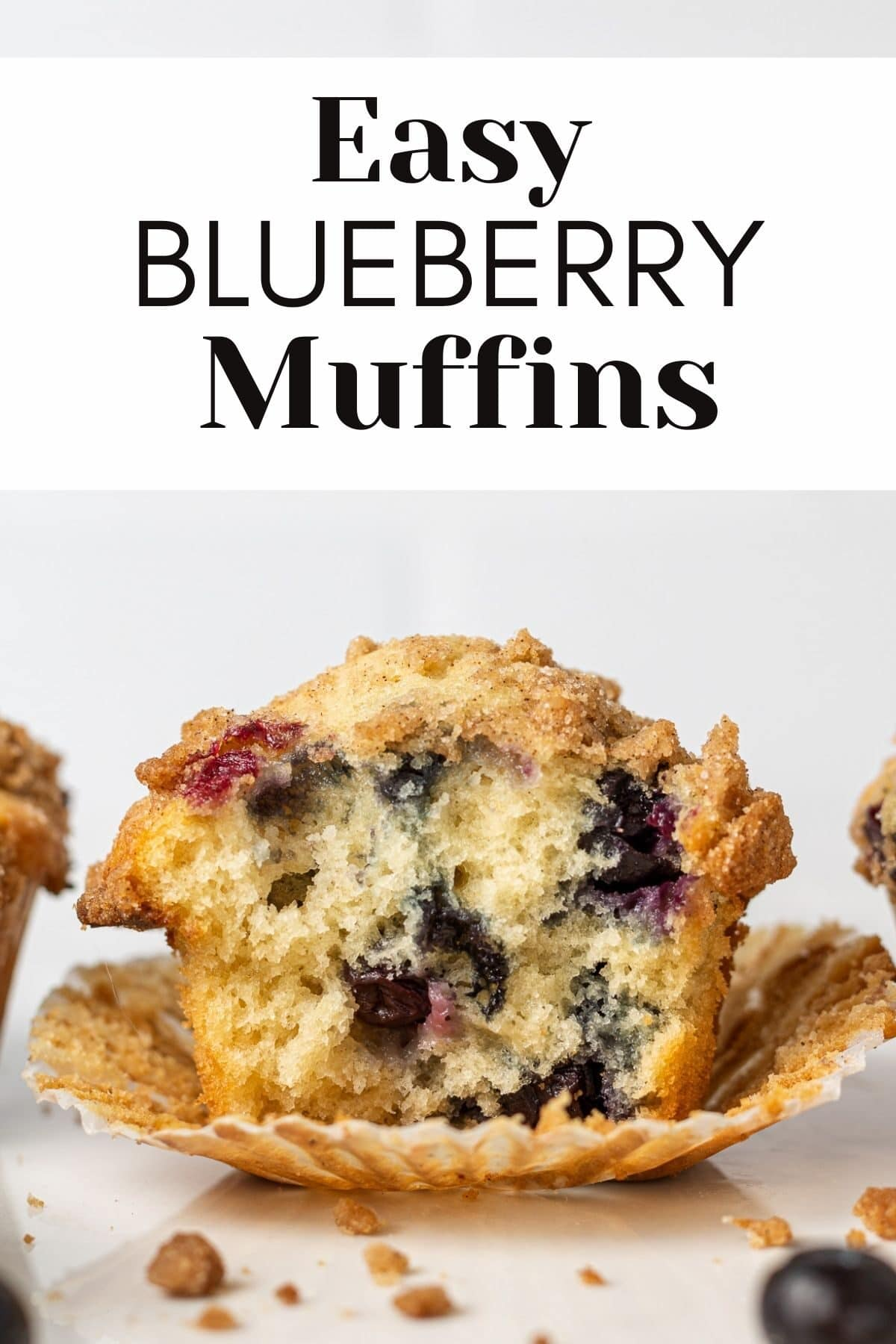 """dairy free blueberry muffin with a bite out of it and crumbs around it with text overlay reading """"easy blueberry muffins"""""""