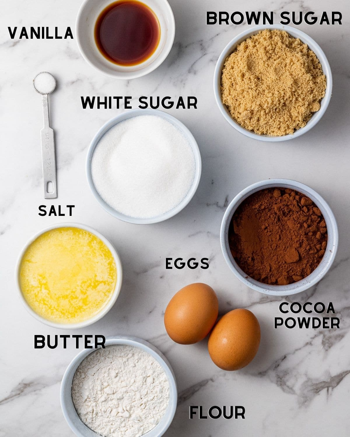ingredients to make dairy free brownies in bowls with text labels