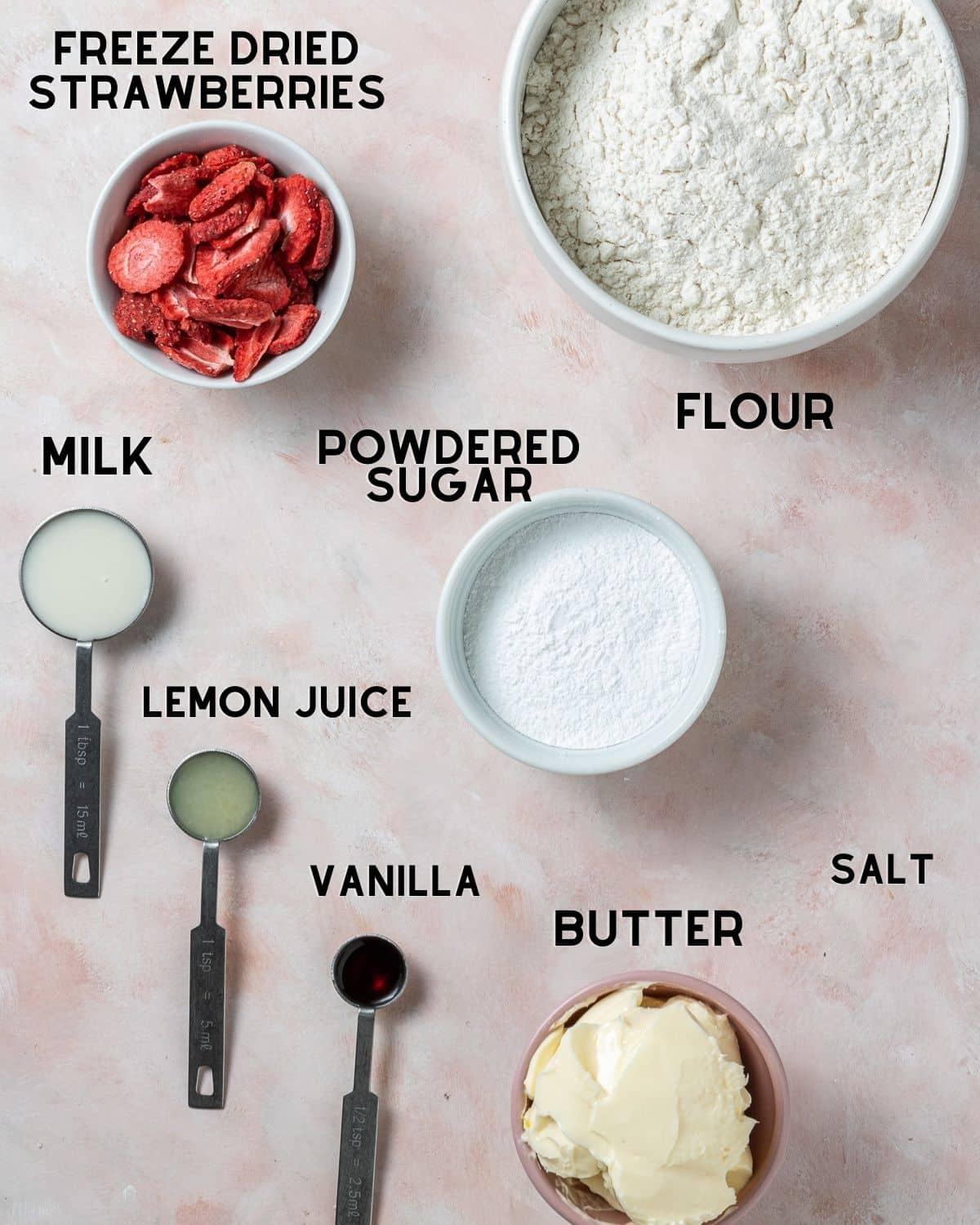 ingredients to make strawberry shortbread cookies in bowls labelled