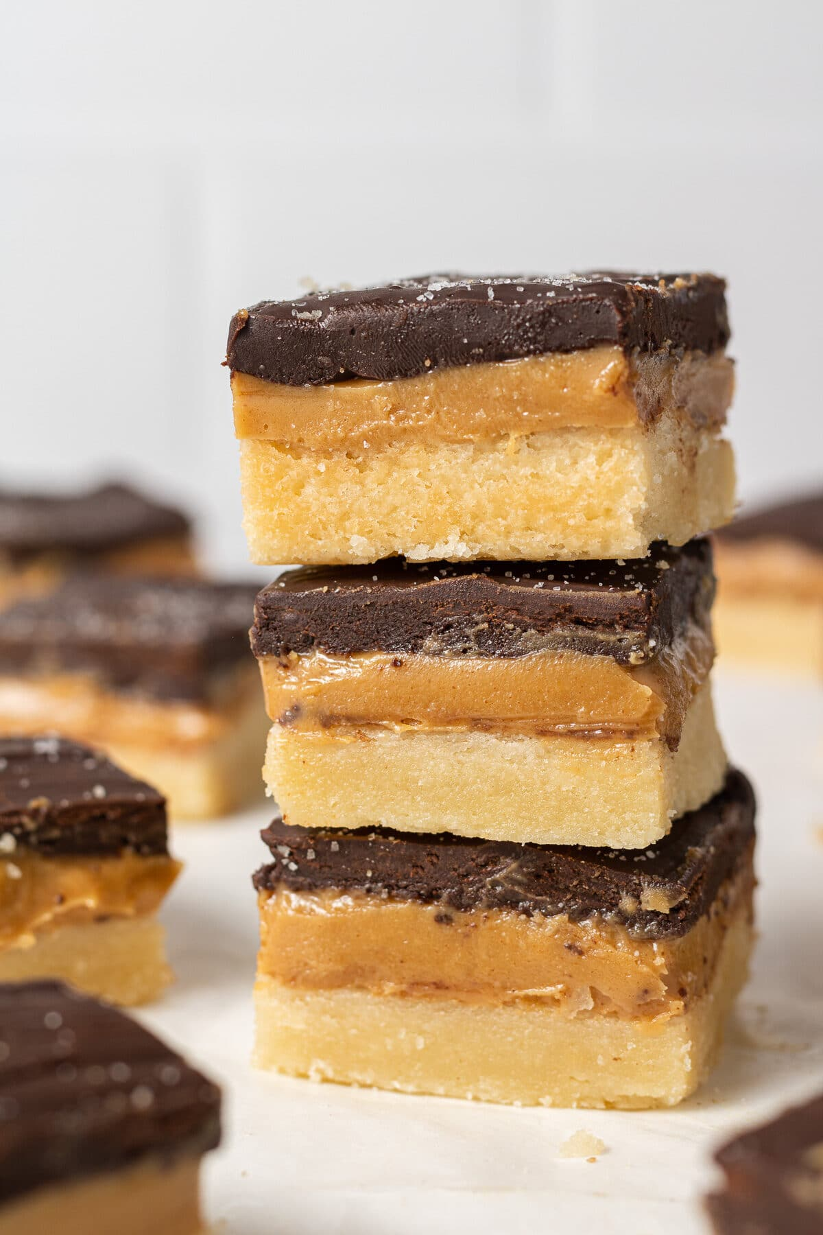 three millionaire shortbread bars stacked on top of each other