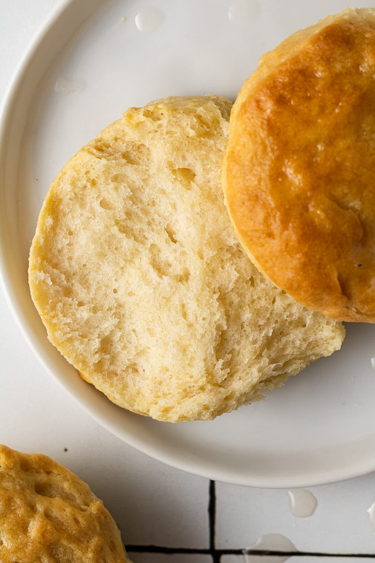 dairy free biscuit on a plate cut in half