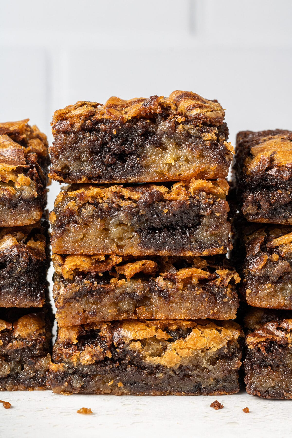 brownie blondies stacked on top of each other with crumbs in front