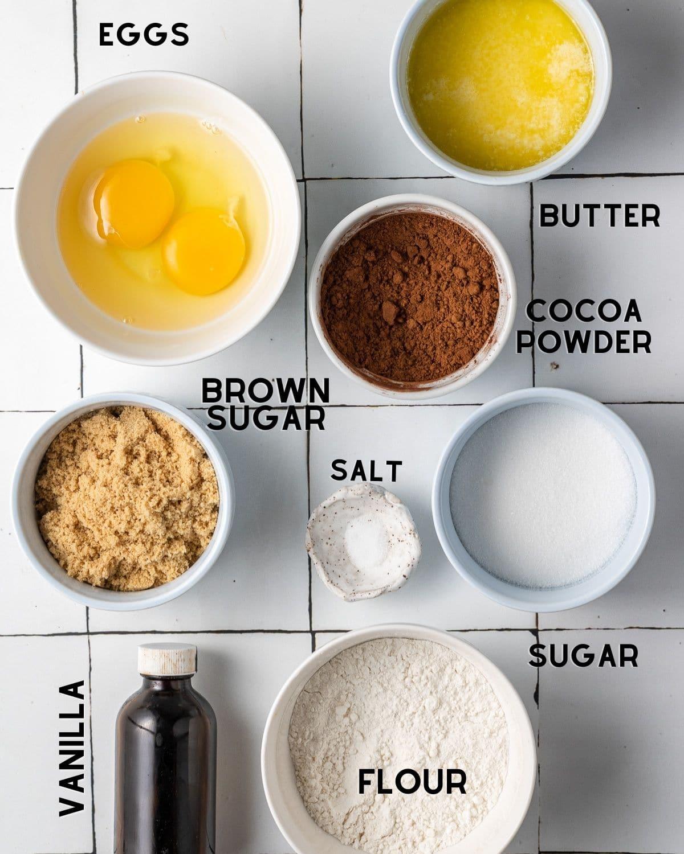 ingredients needed to make brownie blondies in bowls with labels