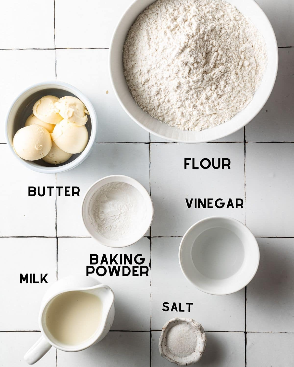 ingredients to make dairy free biscuits in bowls with labels