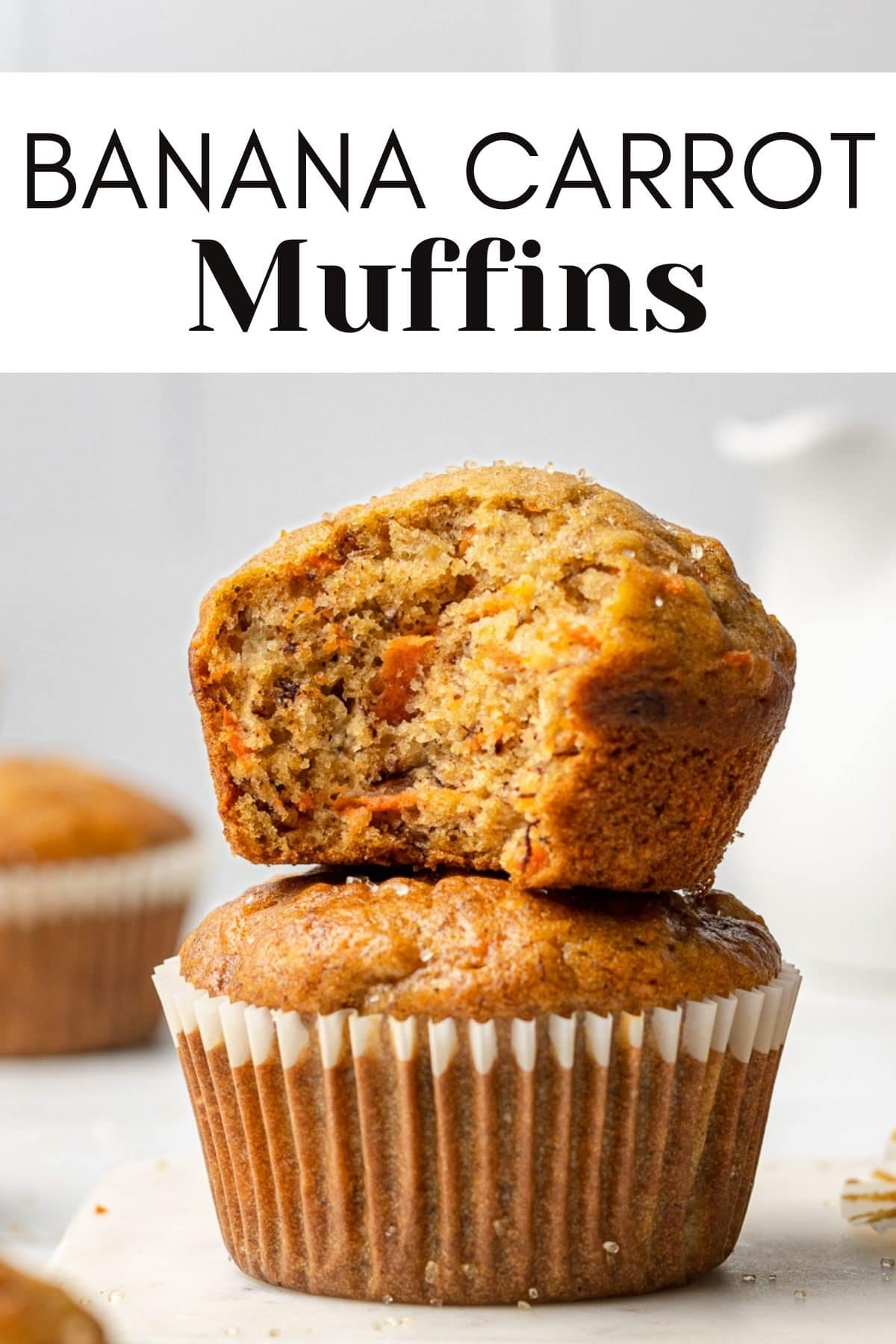 two banana carrot muffins stacked on each other with a bite out of one of them with text overlay for pinterest