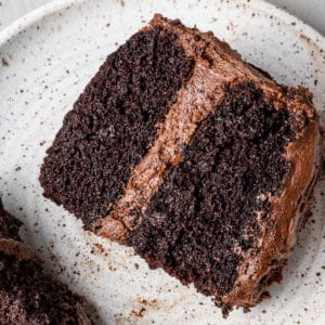 a thick slice of dairy free chocolate cake on a plate overhead
