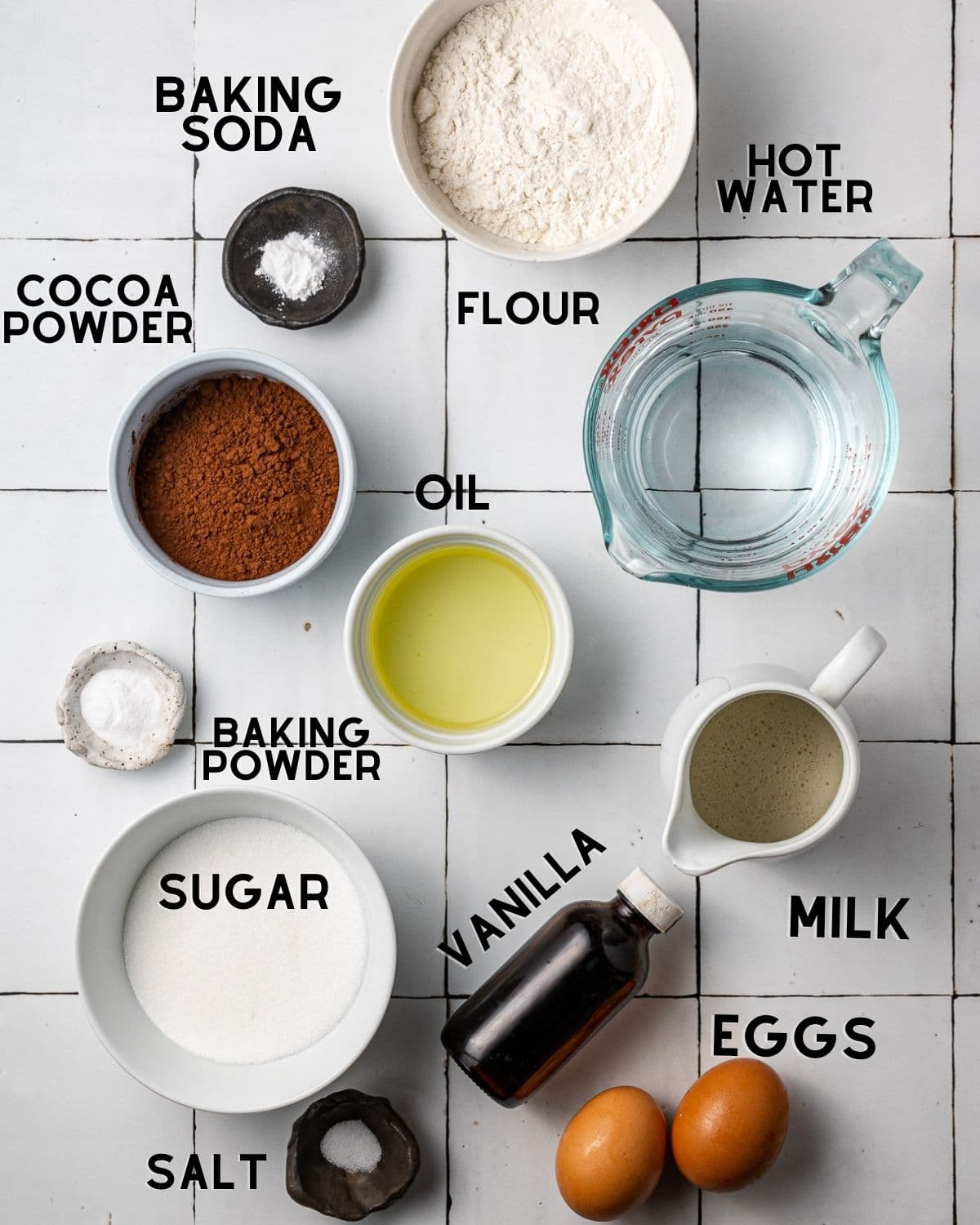 ingredients to make dairy free chocolate cake in bowls with labels