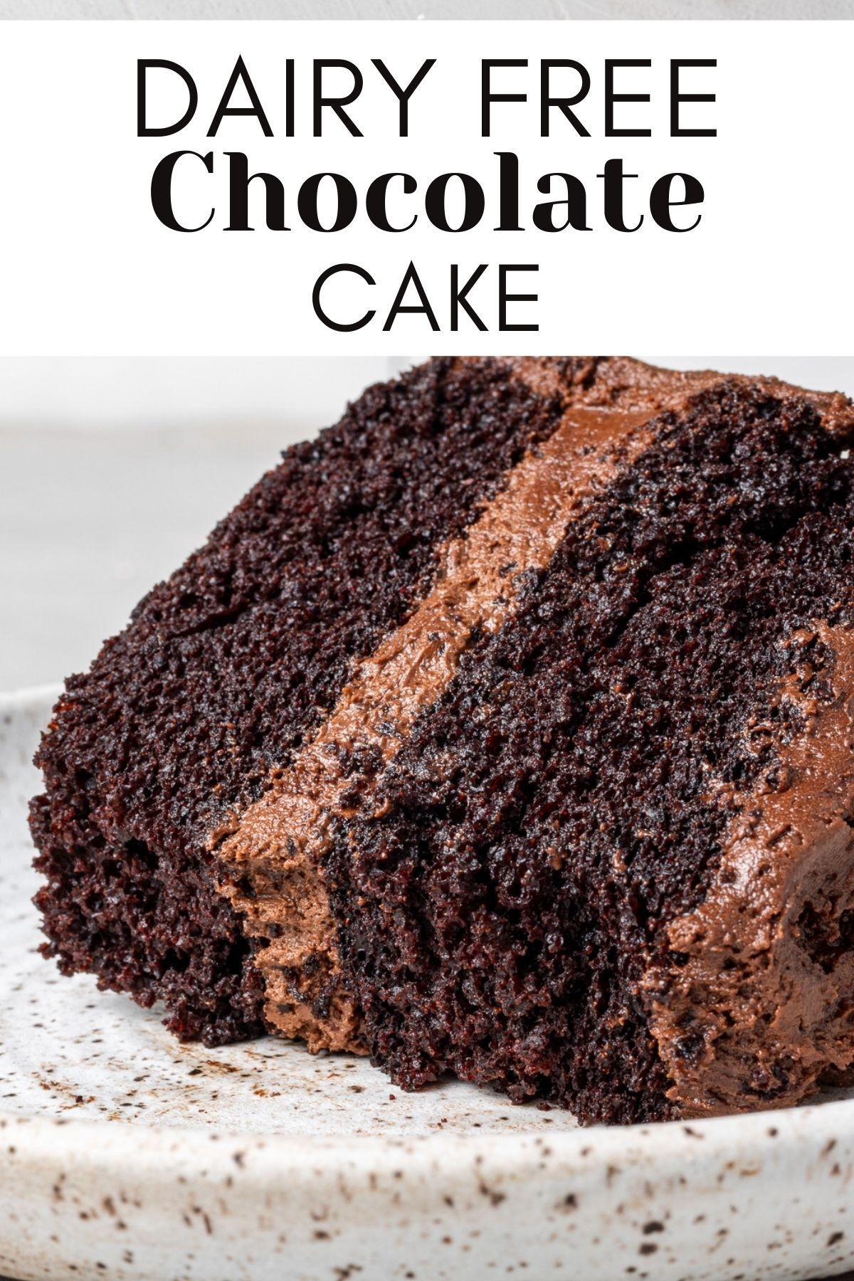 a piece of dairy free chocolate cake on a plate with a bite taken out of it and text overlay for pinterest