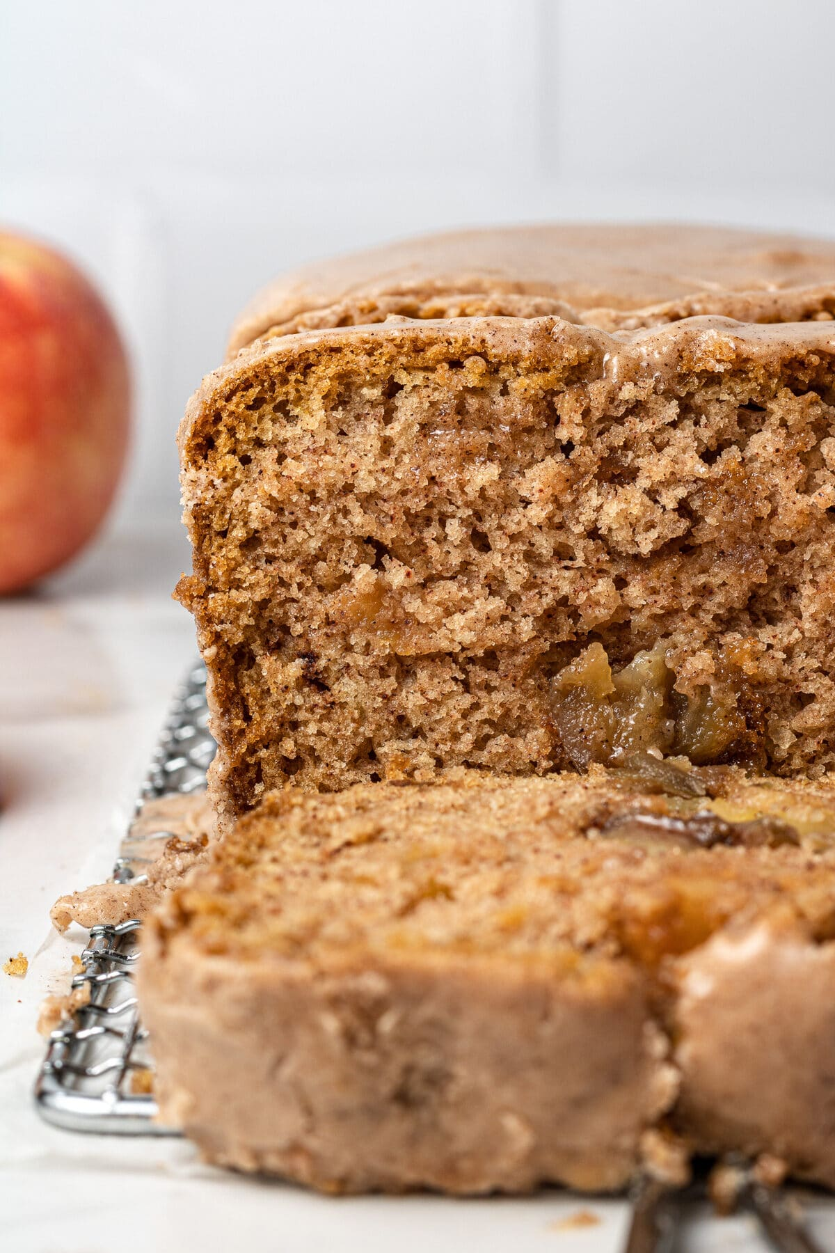 apple cake load sliced with an apple in the background