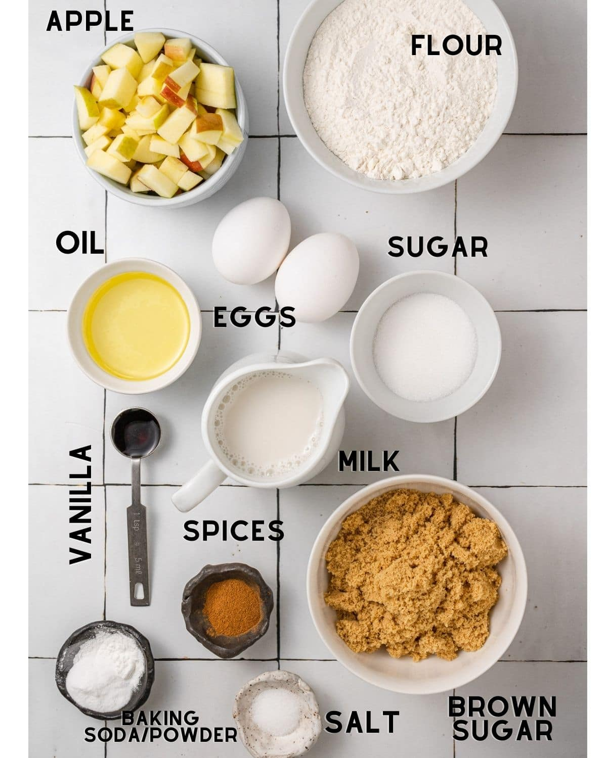 ingredients to make apple cake loaf in bowls with labels