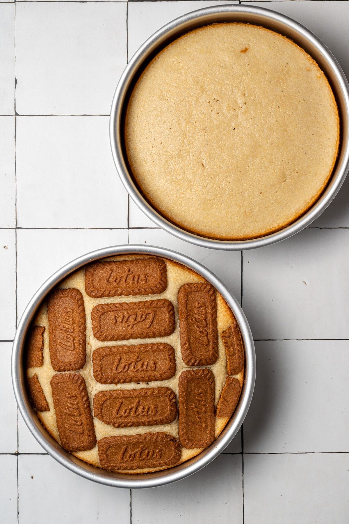 two biscoff cakes baked in the cake pans before being assembled