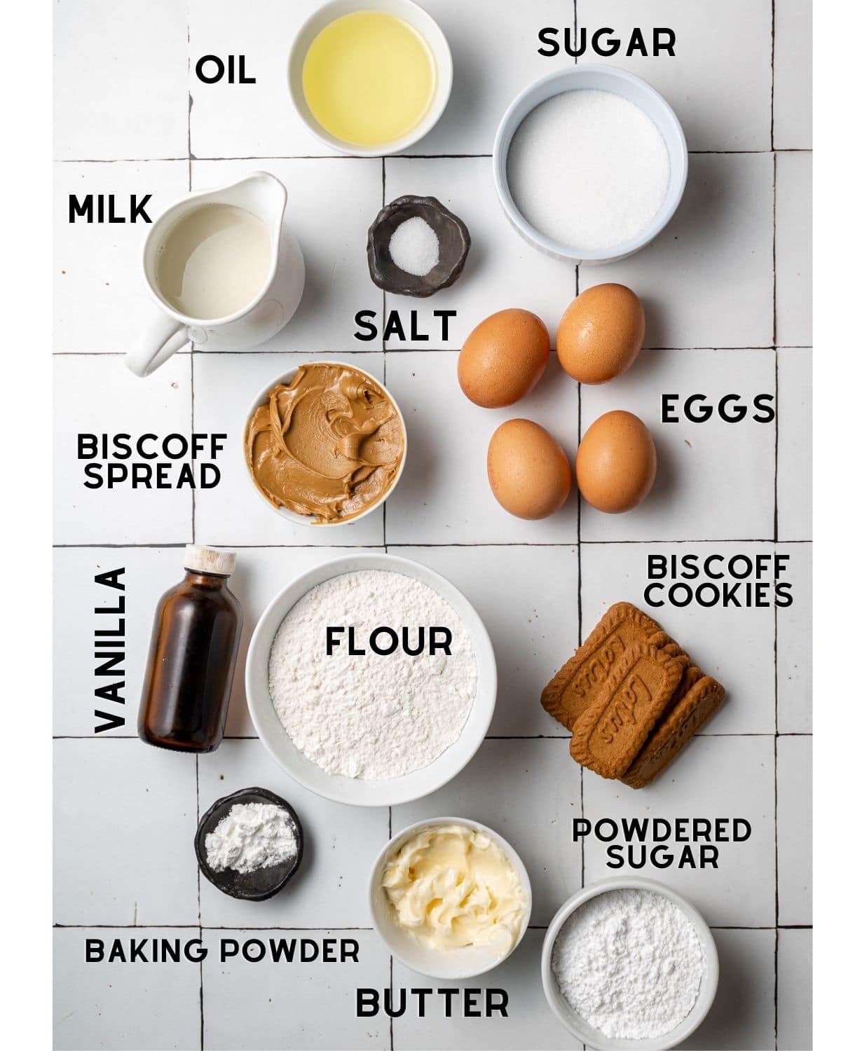 ingredients needed to make biscoff cake in bowls with labels