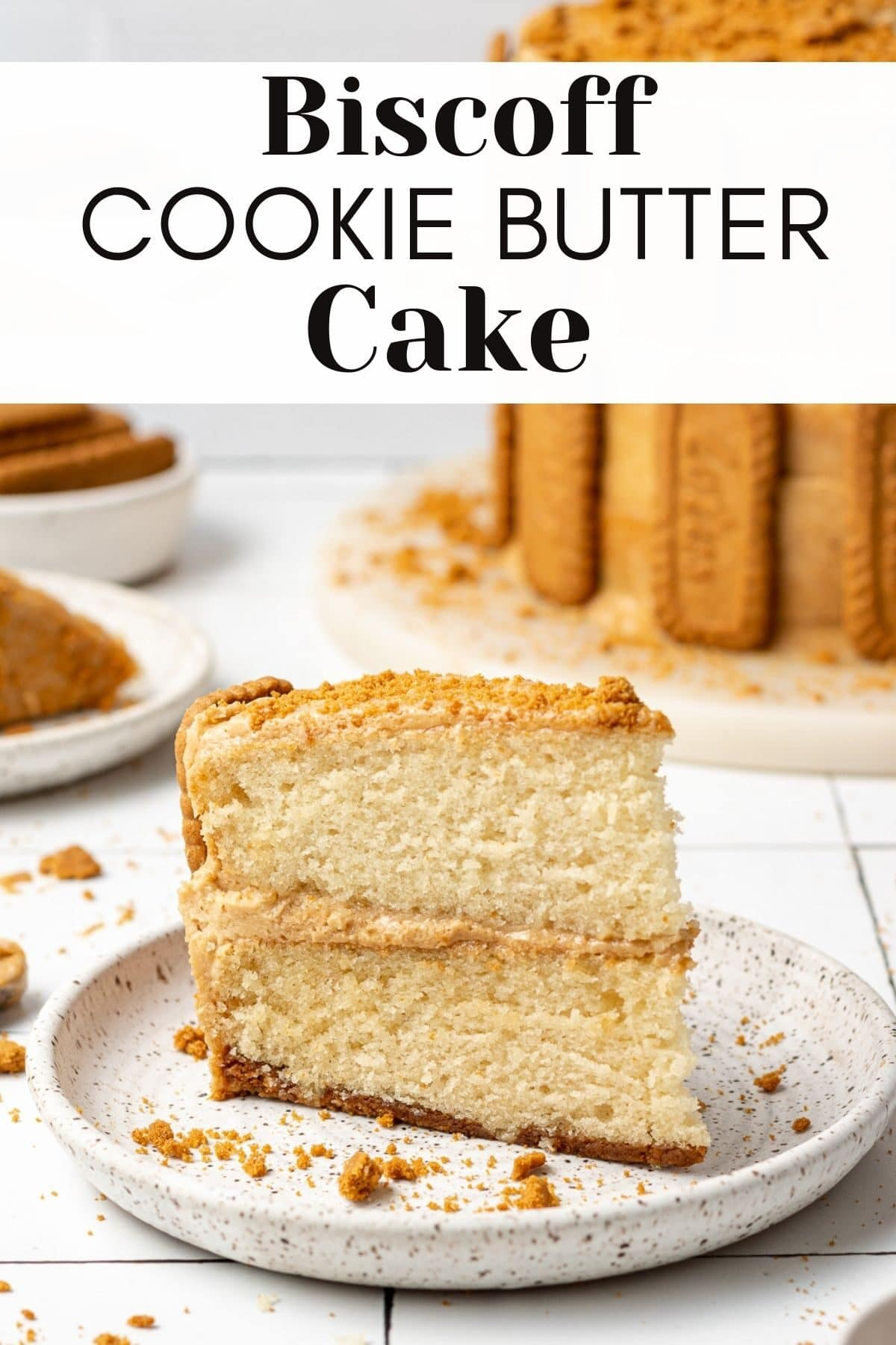 biscoff cake sliced on a plate with text overlay for pinterest