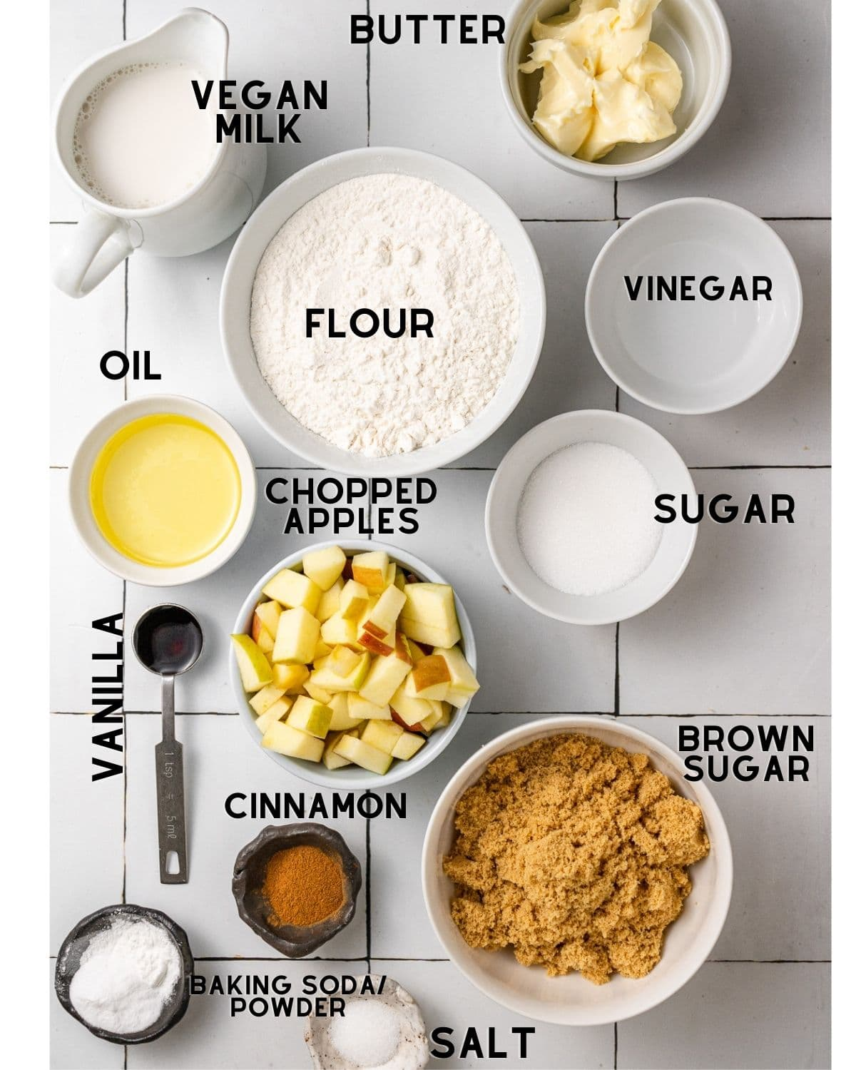 ingredients needed to make vegan apple cake in bowls with labels