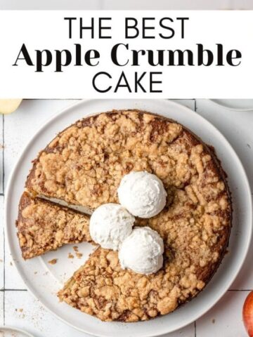 apple crumble cake on a plate with a slice out of it and text overlay