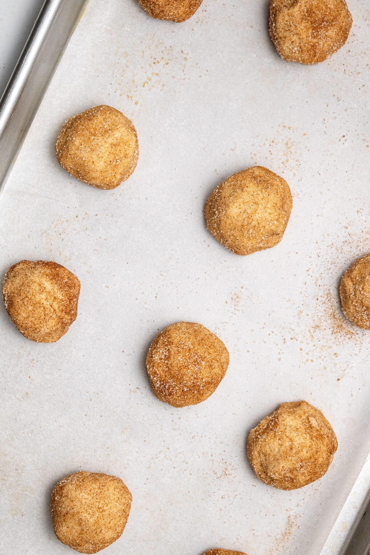 a baking sheet with snickerdoodle cookies before being baked